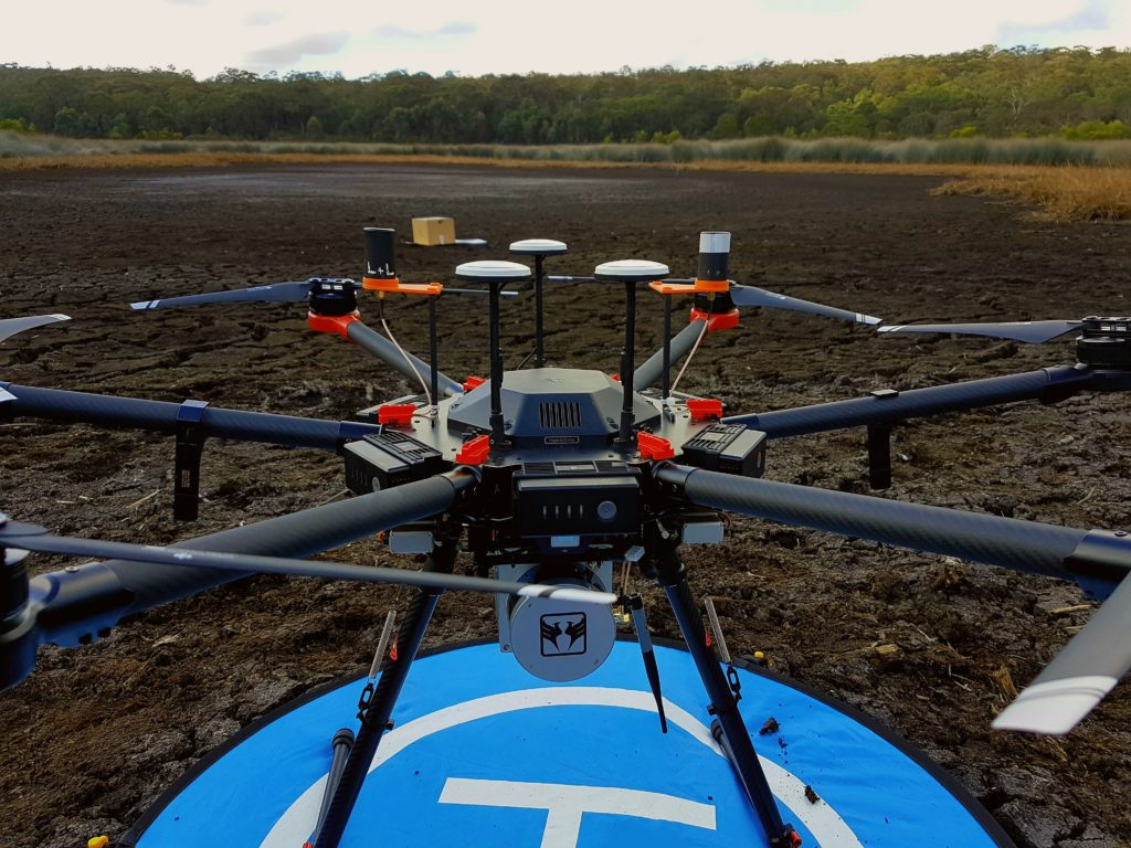 Drone on landing pad in coastal wetland (courtesy Chris Drummong, UNSW WRL).